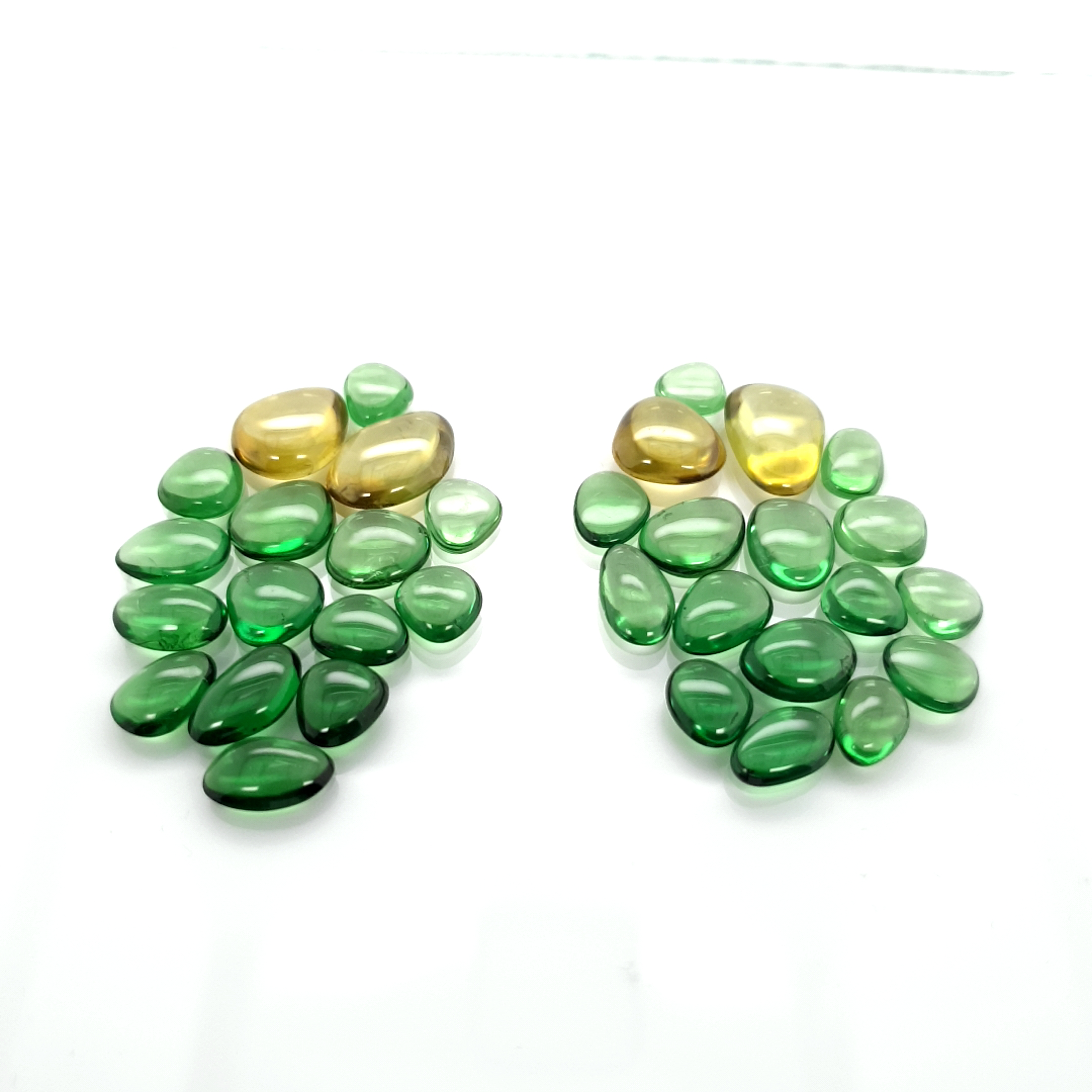 Set Fancy Cabochon Tsavorite 1-2 ct.size and Sphene 3-4 ct.size__2021-03-05-14-44-26